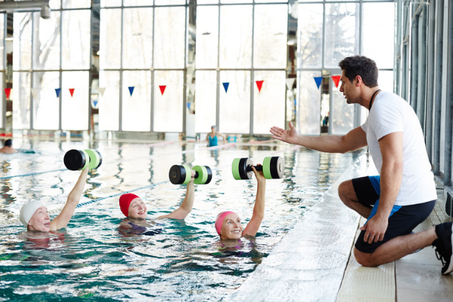 Exercises with dumbbell in water